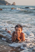 Young Boy between waves, Corfù, Greece.
