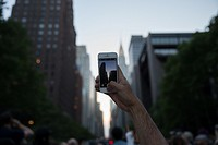 "(150531) -- NEW YORK, May 31, 2015 () -- A man waits to take photos of """"Manhattanhenge"""" in the Manhattan, New York, the United States, on May 30, 20..."