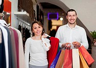couple with shopping bags at store
