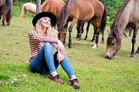 Woman enjoying horses company