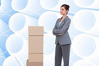 Composite image of thoughtful woman with cardboard boxes