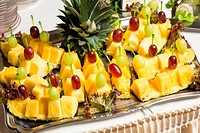 Buffet with pineapple and grapes appetizers and other fruits in restaurant