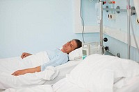 Male patient lying on a medical bed