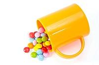 colorful chocolate and mug