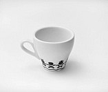 White cup with childish drawing on it