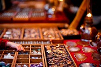 accessory selling at a market in evening