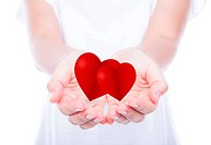 Heart on woman hands over body isolated on background.