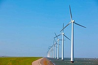 Row of Windturbines with a clear blue sky