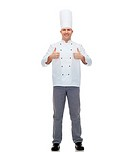 cooking, profession, gesture and people concept - happy male chef cook showing thumbs up