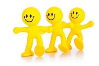 Three persons cheerfully walks forward.