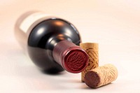 Corks and red wine bottle