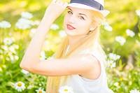 Outdoor summer portrait of young pr