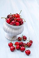 Ripe cherries on a wooden background