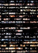 Full frame of highrise building windows at night