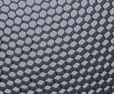 Close up of black net. Gray light.