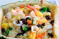 rice with seafood in a pineapple