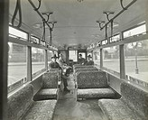 Men in hats and coats in the interior of an electric tram, London, 1933. Passengers sitting in the lower saloon of a London County Council electric tr...