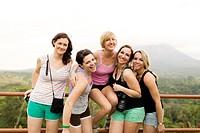 Smiling women by railing