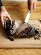 Slicing beef's heart stuffed with prunes