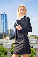 vertical portrait of a business woman on background of sky