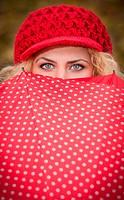 Blue eyes over red umbrella