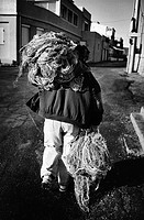 Fisherman carrying fishing nets at the harbor of Goudes