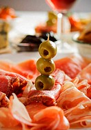 Prosciutto with green olives