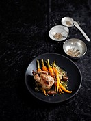 Roasted quail with dates and confit carrots