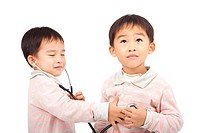 two boys using stethoscope Check the heartbeat