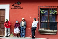 Antigua, Guatemala. People Talking while waiting for a Bus.