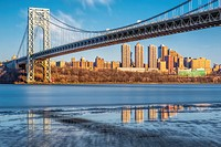 George Washington Bridge NYC Reflections - Wide view of the George Washington Bridge with the New York City skyline during low tide at the Hudson Rive...