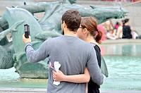 London, England, UK. Young couple in Trafalgar Square taking a selfie.