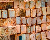 A new delivery of building bricks stacked on a building site - ready for use.