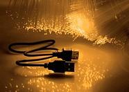USB plugs closeup with fiber optical background