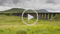 Time lapse of the Ribblehead Viaduct with Ingleborough behind and a passing steam train Yorkshire Dales England
