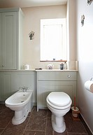 Bathroom interior in a home in the UK in a pastel blue - green color.