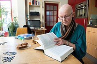 Tilburg, Netherlands. Portrait of a 55 year old, bald female, wearing glasses, born with a genetic disorder, cousing AEC Syndrome / AE Syndrome, a for...