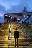 Man waiting on the stairs,Bikini Shoping Mall,Berlin,Germany.