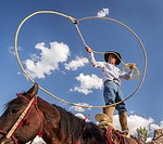 A Mexican charro or cowboy practices roping skills on his horse before a Charreada competition at a hacienda ranch in Alcocer, Mexico. The Charreada i...