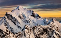 Mt Tutoko (2,723 m) at dawn, highest peak in Darran Mountains, aerial view over Hollyford Valley, Fiordland National Park, New Zealand.