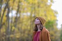 Brunette Woman in Park in Autumnn