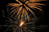 White and gold fireworks against a black sky background at night, Laval, Quebec, Canada.