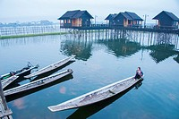 An early morning boater sets out from Garden Island Cottages at Inle Lake.