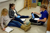 6th Grade Girls Working Together on Science Project, Wellsville, New York, USA.