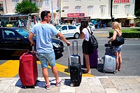 Tourists waiting for bus and taxi outside old town of Dubrovnik, Croatia.