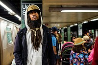 New York City, USA. Urban African-American male waiting for his subway train home bound at Union Square Subway Station, Manhattan.