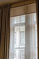 Manhattan, New York City - Looking Through Sheer Curtain Covered Window in the Flatiron District, at a Cast Iron Building Across the Street.