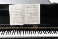 Sheet music and piano.