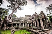 Locals in Preah Khan Temple in Angkor, which is located near Siem Reap (province of Siem Reap, Cambodia).