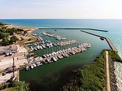 Aerial view of a Small town man made harbor on Lake Huron at Port Sanilac Michigan on Lake Huron.